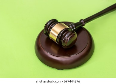 Law symbols  -  gavel isolated on green background