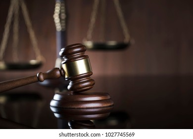 Law symbols on brown background. Books, scales, gavel, statue of justice.