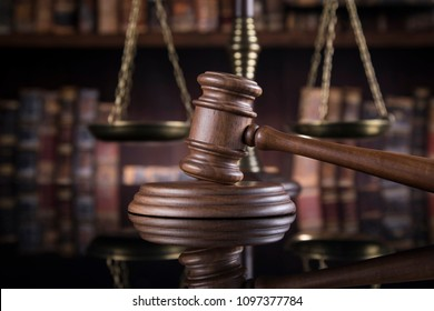 Law theme, mallet of the judge, justice scale, mirror reflection background