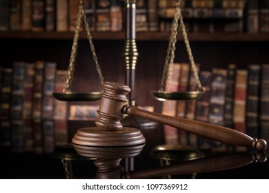 Law theme, mallet of the judge, mirror reflection background
