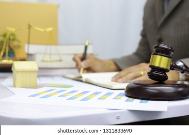 lawer advisor is standing to record information in a journal.