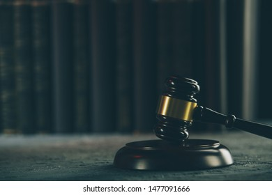 Lawer and notery concept. Wooden gavel on the table isolated.
