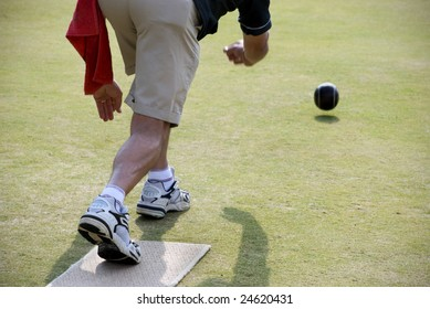 Lawn Bowler in Action from behind.