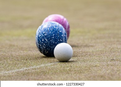 Lawn bowling - Jack with two close bowls.