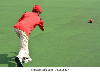 Lawn bowls athlete during tournament