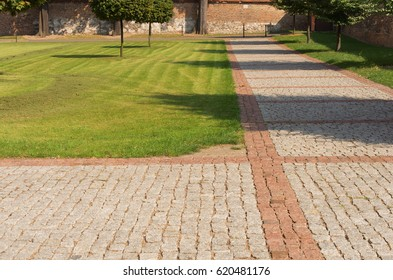 Lawn with a cobbled path in the park