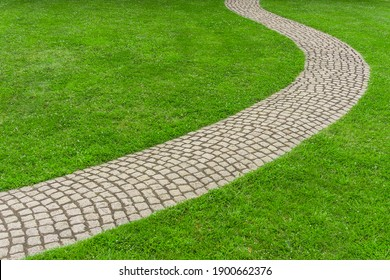 Lawn with curved paved garden path