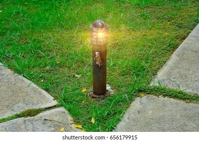 Lawn lamp with garden pathway and backdrop