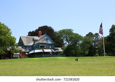 lawn and residential home and american flag pole