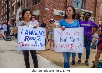 LAWRENCE, MA, USA – JULY 20, 2017: Demonstrators protest US Representative Paul Ryan's visit to the New Balance factory.