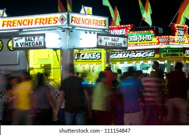 LAWRENCEVILE, GA, USA - SEPTEMBER 24:  Unidentified patrons walk amongst a variety of fast food vendors at the Gwinnett County Fair in Lawrenceville on September 24, 2011