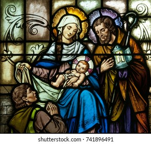 LAWRENCEVILL, NJ - October 25, 2017: Stained glass window depicting Christmas scene of Nativity of Jesus, with Mary and Joseph and a shepherd