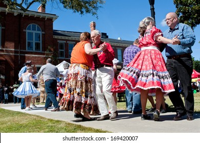 LAWRENCEVILLE, GA - OCTOBER 12:  Senior citizens square dance outdoors at the Old Fashioned Picnic and Bluegrass Festival on October 12, 2013 in Lawrenceville, GA. The event was free to the public.