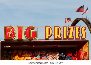 "LAWRENCEVILLE, GA - SEPTEMBER 17:  ""Big Prizes"" sign sits atop carnival game filled with stuffed animals at the Gwinnett County Fair, on September 17, 2016 in Lawrenceville, GA."