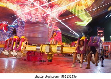 LAWRENCEVILLE, GA - SEPTEMBER 17:  A composite of two images shows motion blur of fast-moving carnival ride at the Gwinnett County Fair, on September 17, 2016 in Lawrenceville, GA.