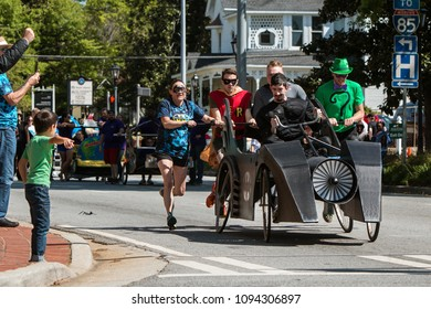 Lawrenceville, GA / USA - April 21, 2018:  A team dressed like characters from the Batman comics, pushes a Batmobile bed in a charity fundraiser event on April 21, 2018 in Lawrenceville, GA.