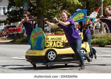 Lawrenceville, GA / USA - April 21, 2018:  A team pushes a bed designed to look like a race car in a charity fundraiser event on April 21, 2018 in Lawrenceville, GA.