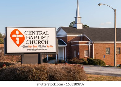 Lawrenceville, GA / USA - January 30 2020: Entrance sign of Central Baptist Church, with church building in the background.