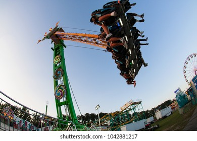 Lawrenceville, GA / USA - September 22, 2017:  Teenagers enjoy the speed and height of a scary ride at the Gwinnett County Fair on September 22, 2017 in Lawrenceville, GA.