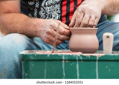 Lawrenceville, GA/USA - April 28 2018:  Closeup of pottery artist's hands forming a bowl as part of a live demonstration at the Lawrenceville Arts Fest on April 28, 2018 in Lawrenceville, GA.