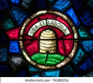 LAWRENCEVILLE, NJ - October 25, 2017: Stained glass window depicting beehive with Latin words, Ora et Labora, the motto of the Benedictine Order