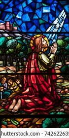 LAWRENCEVILLE, NJ - October 25, 2017: Stained glass window depicting Jesus praying in the Agony of the Garden scene