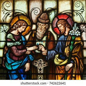 LAWRENCEVILLE, NJ - October 25, 2017: Stained glass window depicting the betrothal of Mary and Joseph, located in oratory of Notre Dame Convent