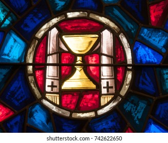 LAWRENCEVILLE, NJ - October 25, 2017: Stained glass window depicting symbols of Holy Mass including a chalice and priest's stole, located in St. Ann Church
