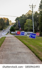 LAWRENCEVILLE, UNITED STATES - Nov 03, 2020: Lawrenceville, Georgia / United States - November 3 2020: Campaign signs along the side of the road near a polling location in Gwinnett County