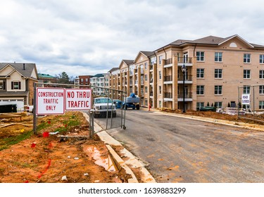 Lawrenceville,GA / USA - February 7 2020: Traffic sign at entrance to Southlawn Lawrenceville apartments construction site along Jackson Street in Lawrenceville, Gwinnett County GA