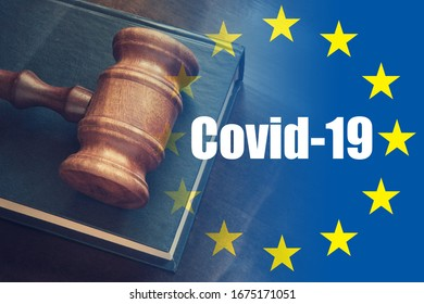 Laws against coronavirus covid-19 in European Union concept. Judge gavel on legal book and EU flag with text covid-19.