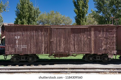 Laws, California USA: September 14, 2018: Historic Southern Pacific railroad narrow gauge wooden boxcar number 7 on display at the Laws Railroad Museum