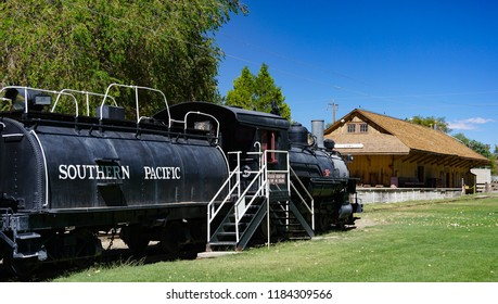 Laws, California USA: September 14, 2018: Historic Southern Pacific railroad tender and locomotive 9, a Baldwin 4-6-0 oil fueled steam engine, built in 1909, at the preserved Laws depot building