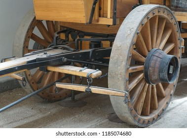 Laws, California USA: September 14, 2018: Front wheel, axle, tongue and hitch assembly on a reproduction of a 20 mule team borax wagon in the Eastern Sierra Owens Valley. Wheels are 5 feet diameter.