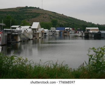LAWTON, OKLAHOMA—SEPTEMBER 2017: Peaceful waters of a marina with boathouses built in the sides near Mt. Scott in Lawton, Oklahoma.