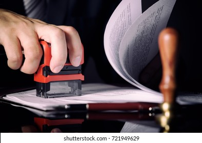 Lawyer or attorney working in office with automatic stamp. law attorney lawyer business man notary public document concept