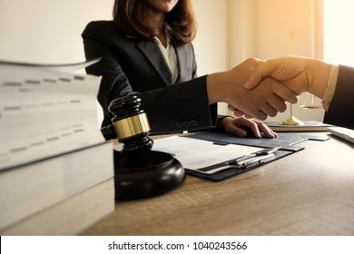 Lawyer business women shaking hands with clients, after finishing up a Consulting for insurance rent house. concept of home protection, family, insurance.