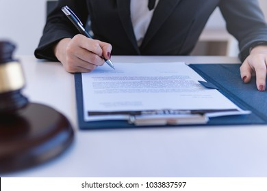 Lawyer business women working and notary signs the documents at office. consultant lawyer, justice and law ,attorney, court judge, concept.