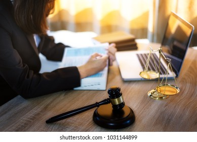 Lawyer business women working and writting in notebook on desk at office. consultant lawyer, justice and law ,attorney, court judge, concept.