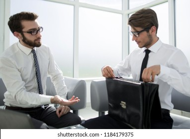 lawyer and businessman sitting in the lobby of the business center
