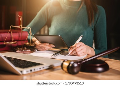 Lawyer businessman and two business partners working together in office. Businessmen sitting at desk and making notes.