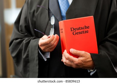 Lawyer with civil law code - only torso to be seen, close-up