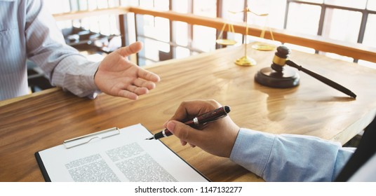 lawyer consultant and client discussing about tax fee / auctions in a office