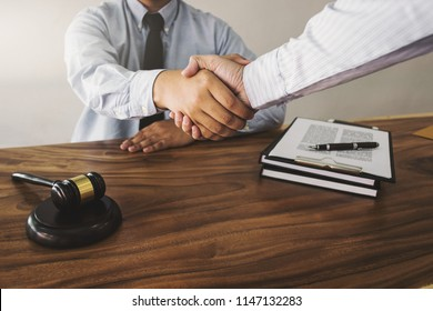 lawyer consultant and client handshaking in a office