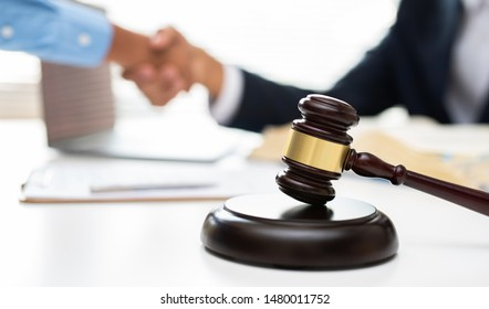 Lawyer, court, judgment, hammer in the foreground