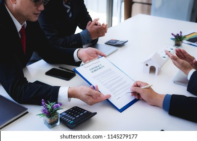 lawyer explain the documents contact of insurance of fire and theft a house at office desk. home protection, family, insurance.rent house concept .