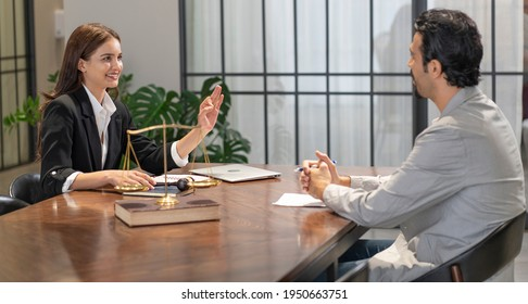 Lawyer gives legal advice and talks to her clients for advice on the rules and regulations that must be followed at the Office of Legal Counsel.