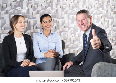 Lawyer Giving Consultation to Two Young Women