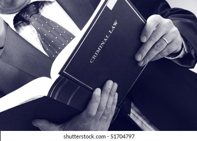 lawyer holding criminal law book, law concept , blue toned