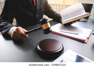 Lawyer holding the hammer and the judge read the verdict.